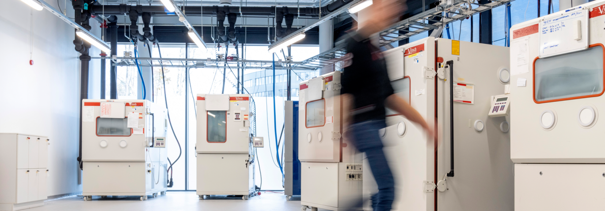 Reliability lab, man walking in environmental lab